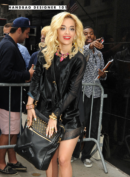 British singer-songwriter Rita Ora seen signing autographs and posing for photos with fans while arriving at a studio in New York to appear on 'Good Morning America'